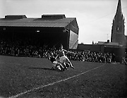 17/04/1960<br /> 04/17/1960<br /> 17 April 1960<br /> League of Ireland final round: St Patrick's Athletic v Limerick at Dalymount Park, Dublin. Wallace of Limerick (right) tries to stop the ball going over the line for a kick out by St Patrick's but failed. Player on the left is Tommy White, St. Patrick's Athletic back who scored an own goal in the first half to give Limerick the lead.