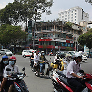 A street scene showing scooters and cars in Ho Chi Minh City, Vietnam. 3rd March 2012. Photo Tim Clayton