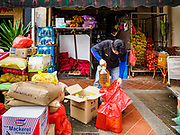 13 DECEMBER 2018 - SINGAPORE: A worker unloads a delivery of groceries to a local grocery shop in the Geylang neighborhood. The Geylang area of Singapore, between the Central Business District and Changi Airport, was originally coconut plantations and Malay villages. During Singapore's boom the coconut plantations and other farms were pushed out and now the area is a working class community of Malay, Indian and Chinese people. In the 2000s, developers started gentrifying Geylang and new housing estate developments were built.      PHOTO BY JACK KURTZ