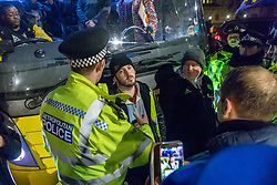 Pro-Brexit campaigner James Goddard in his 'gilet juane' attempts to stop a bus emblazoned with Bollox to Brexit as it arrives at Steve Bray's ongoing pro-remain protest at Old Palace Yard outside Parliament. Westminster, London, December 20 2018.