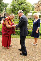 The Dalai Lama is greeted by Prince Charles, Prince of Wales and Camilla, Duchess of Cornwall as he arrives to plant a tree to commemorate his visit at Clarence House in London on May 22, 2008..Photo by Anwar Hussein