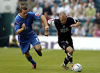 Photo: Olly Greenwood.<br />Gillingham v Swansea City. Coca Cola League 1. 16/09/2006. Gillingham's Mark Bentley (L) and Swansea's Andy Robinson.