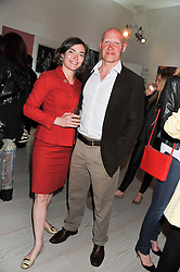 CAMILLA RUTHERFORD and DOMINIC BURNS at a party hosted by Ines de la Frassange and Bruno Frisoni for Roger Vivier to launch the Roger Vivier book held at The Saatchi Gallery, London on 24th April 2013.