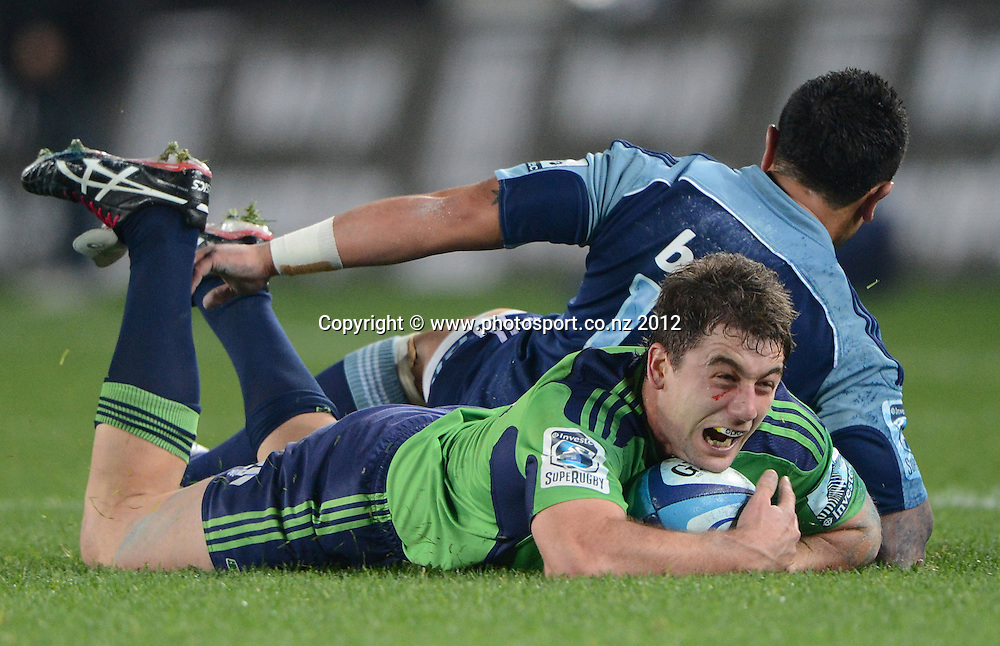 Kurt Baker dives in the ball during the Blues and Highlanders at Eden Park, Auckland, New Zealand on Saturday 26 May 2012. Photo: Andrew Cornaga/Photosport.co.nz