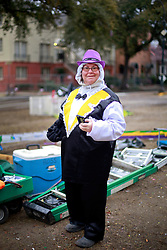 17 Feb 2015. New Orleans, Louisiana.<br /> Early morning Mardi Gras Day. A woman in costume prepares for Fat Tuesday on St Charles Avenue before the big parades start to roll.<br /> Photo; Charlie Varley/varleypix.com