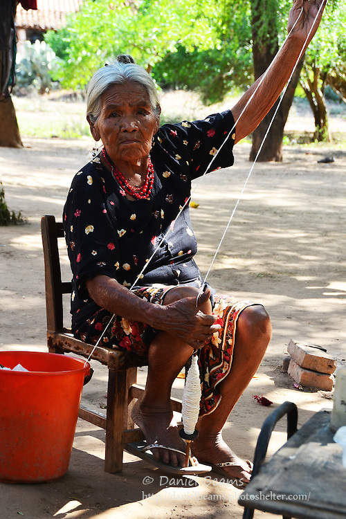 Guarani woman hand spinning yarn