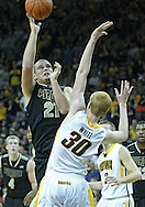 December 28, 2011: Purdue Boilermakers guard/forward D.J. Byrd (21) puts up a shot over Iowa Hawkeyes forward Aaron White (30) during the NCAA basketball game between the Purdue Boilermakers and the Iowa Hawkeyes at Carver-Hawkeye Arena in Iowa City, Iowa on Wednesday, December 28, 2011. Purdue defeated Iowa 79-76.