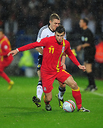 Wales Gareth Bale (Tottenham) battles for the ball with Scotland's Darren Fletcher (Manchester United) - Photo mandatory by-line: Joe Meredith/JMP  - Tel: Mobile:07966 386802 12/10/2012 - Wales v Scotland - SPORT - FOOTBALL - World Cup Qualifier -  Cardiff   - Cardiff City Stadium -