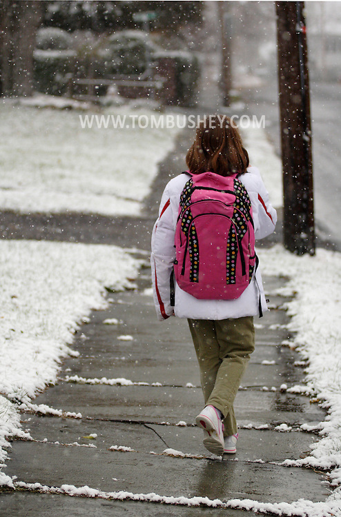 Middletown, NY - An 8-year-old girls walks to the school , bus stop during the first snowfall of the season on Nov. 19, 2007. MR