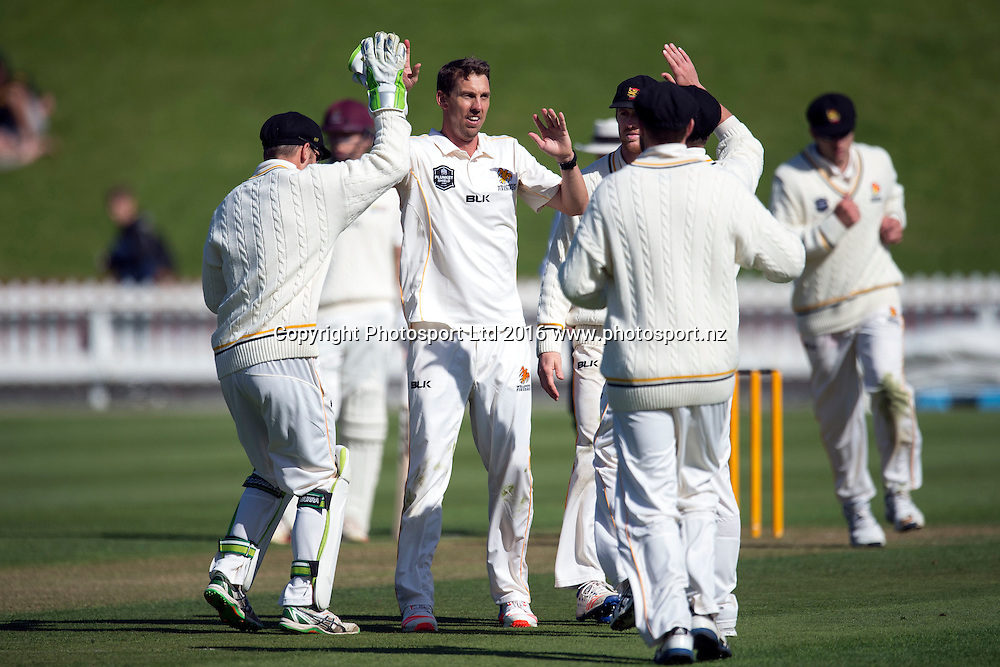 Wellington's players celebrates the fall of a wicket during the Day 2 of the Plunket Shield cricket match, Wellington v Northern Districts, at Basin Reserve, Wellington. 30th October 2016. Copyright Photo: Raghavan Venugopal / www.photosport.nz