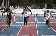 Jun 22, 2019; Miramar, FL, USA; Tai Brown of Kentucky (center) defeats Eric Edwards of Oregon (right) to win the 110m hurdles, 13.204 to 13.209, during the USATF U20 Championships at Ansin Sports Complex.  Jamar Marshall (left) was third in 13.22.