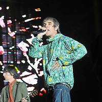 WESTON PARK, UK:.Ian Brown and guitarist John Squire of The Stone Roses on stage at the V Festival on Sunday 19th August 2012..PHOTOGRAPH BY TERRY KANE / BARCROFT MEDIA LTD..UK Office, London..T: +44 845 370 2233.E: pictures@barcroftmedia.com.W: www.barcroftmedia.com..Australasian & Pacific Rim Office, Melbourne..E: info@barcroftpacific.com.T: +613 9510 3188 or +613 9510 0688.W: www.barcroftpacific.com..Indian Office, Delhi..T: +91 997 1133 889.W: www.barcroftindia.com