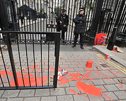 © Licensed to London News Pictures. 07/10/2011. LONDON. UK. A group of London Catholic Workers staged a sit down protest at the Entrance to Downing Street today (07/10/11) They threw household red emulsion paint at the entrance gates. Photo credit:  Stephen Simpson/LNP