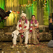 A young couple are tired of posing for the photographers during their Hindu Punjabi wedding in New Delhi, India 2008