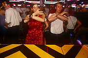 Passengers enjoy the night entertainment of disco dancing, on 15th May 1996, aboard the Carnival cruise ship Ecstasy, off the Gulf of Mexico, USA.