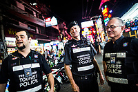 Volunteers of the Foreign Tourist Police patrol Walking Street--an infamous entertainment area--in Pattaya, Thailand.