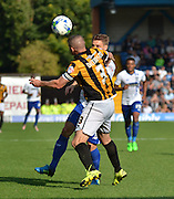 Carl Dickinson is first to the ball during the Sky Bet League 1 match between Bury and Port Vale at Gigg Lane, Bury, England on 19 September 2015. Photo by Mark Pollitt.