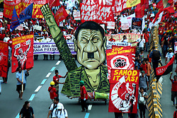 "July 24, 2017 - Philippines - The effigy of President Rodrigo Roa Dutertwe as ""Hitler"" was parade with thousands of multi-sectoral group contingent groups march going to House of Representative to conduct their own version of SONA ng Bayan during the 2nd State Of the Nation Address of President Rodrigo Roa Dutertwe inside of Batasan Pambansa in Quezon City on July 24, 2017. (Credit Image: © Gregorio B. Dantes Jr/Pacific Press via ZUMA Wire)"