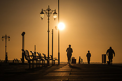 © Licensed to London News Pictures. 12/09/2017. Southsea, UK.  People enjoying the clear, but brisk weather along Southsea Promenade shortly after sunrise this morning, 12th September 2017. Photo credit: Rob Arnold/LNP