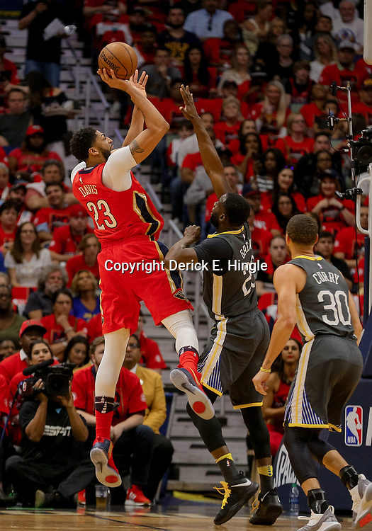 May 4, 2018; New Orleans, LA, USA; New Orleans Pelicans forward Anthony Davis (23) shoots over Golden State Warriors forward Draymond Green (23) during the first quarter in game three of the second round of the 2018 NBA Playoffs at Smoothie King Center. Mandatory Credit: Derick E. Hingle-USA TODAY Sports