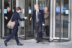 "© Licensed to London News Pictures. 10/11/2018. London, UK. JO JOHNSON MP and his father STANLEY JOHNSON are seen leaving BBC Broadcasting House in London after JO JOHNSON resigned as transport minister yesterday. Mr Johnson, brother of former foreign secretary Boris Johnson, resigned his ministerial post saying it's ""imperative we go back to the people and check"" they still want to leave. Photo credit: Ben Cawthra/LNP"