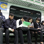 South Korean's traveling on the Seoul Metropolitan Subway, Seoul, South Korea. 22nd March 2012. Photo Tim Clayton