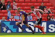 Danny Wright and Callum Howe during the Vanarama National League match between Lincoln City and Cheltenham Town at Sincil Bank, Lincoln, United Kingdom on 8 August 2015. Photo by Antony Thompson.