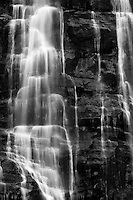 Bridal Veil Falls near Provo, Utah.  The details of the white falling water contrast against the dark rock of the mountain.