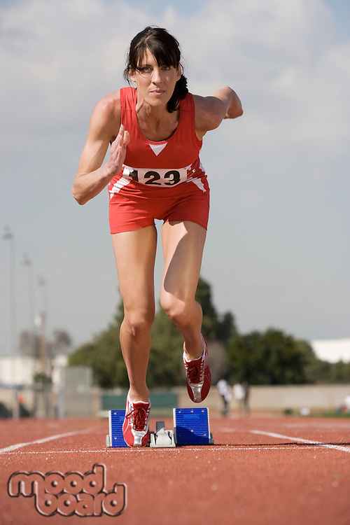 Female athlete starting to run