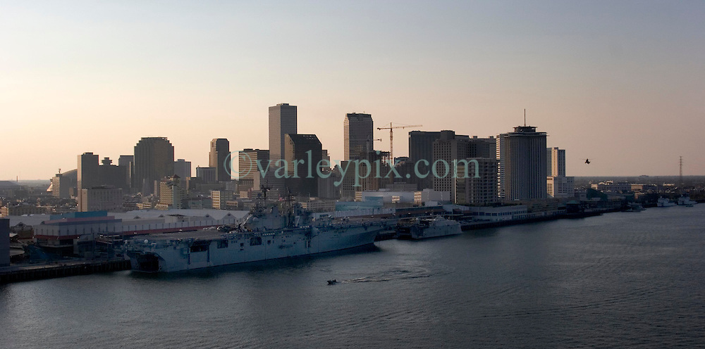 06 Sept 2005. New Orleans, Louisiana.  <br /> <br /> Downtown New Orleans following Hurricane Katrina. The U.S Battleship Iwo Jima sits alongside the tourist river walk area as the sun sets on yet another day in the broken city.<br /> Photo; &copy;Charlie Varley/varleypix.com