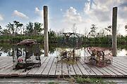 crab traps on dock; Bayou La Loutre at Shell Beach, Louisiana