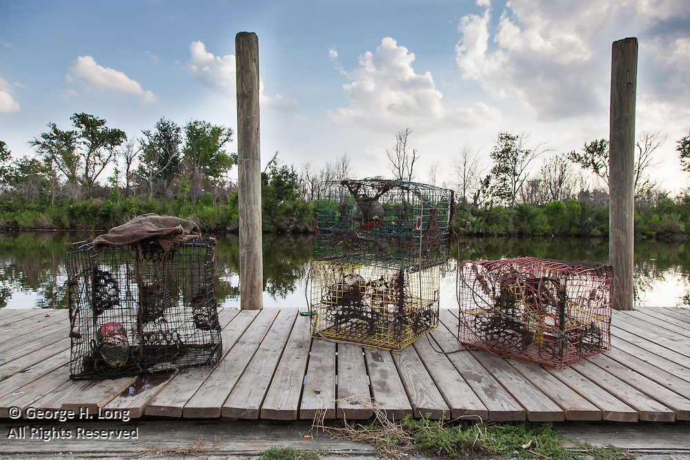 crab traps on dock; Bayou La Loutre at Shell Beach, Louisiana