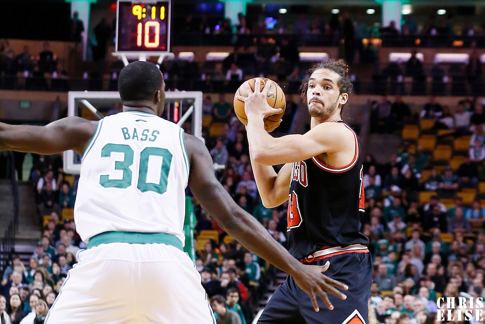 18 January 2013: Chicago Bulls center Joakim Noah (13) looks to pass the ball over Boston Celtics power forward Brandon Bass (30) during the Chicago Bulls 100-99 overtime victory over the Boston Celtics at the TD Garden, Boston, Massachusetts, USA.
