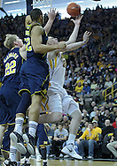 January 14, 2011: Iowa Hawkeyes forward Aaron White (30) puts up a shot around Michigan Wolverines forward Blake McLimans (22) and Michigan Wolverines forward Jordan Morgan (52) during the NCAA basketball game between the Michigan Wolverines and the Iowa Hawkeyes at Carver-Hawkeye Arena in Iowa City, Iowa on Saturday, January 14, 2011. Iowa defeated Michigan 75-59.