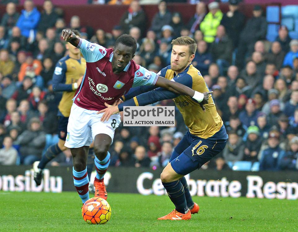 Idrissa Gana of Villa holds off Aaron Ramsey of Arsenal......(c) BILLY WHITE | SportPix.org.uk