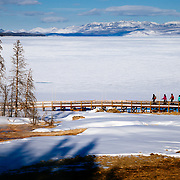 Clients explore the West Thumb area of Yellowstone National Park in winter.