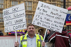 London, UK. 29th January, 2019. A pro-Brexit protester holds two placards outside Parliament on the day of votes in the House of Commons on amendments to the Prime Minister's final Brexit withdrawal agreement which could determine the content of the next stage of negotiations with the European Union.