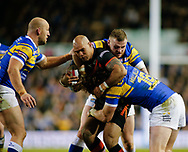 Anthony Mullally (R), Carl Ablett (L) and Brad Singleton of Leeds Rhinos tackle Jake Webster of Castleford Tigers during the Betfred Super League match at Elland Road, Leeds<br /> Picture by Stephen Gaunt/Focus Images Ltd +447904 833202<br /> 23/03/2018