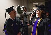 Spike offers celebratory high fives to Law School graduates. (Photo by Gonzaga University)