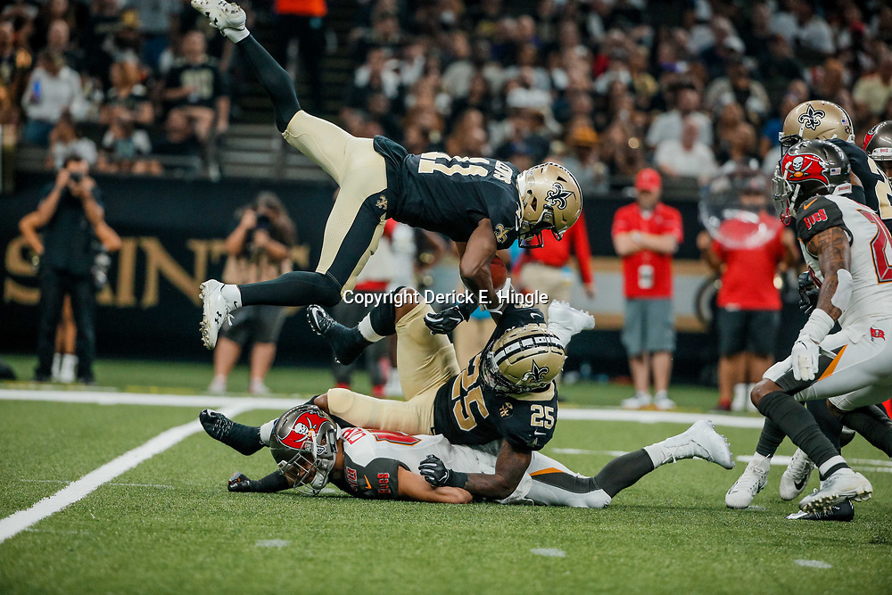 Sep 9, 2018; New Orleans, LA, USA; Tampa Bay Buccaneers linebacker Jack Cichy (48) upends New Orleans Saints kick returner Tommylee Lewis (11) during the first half of a game at the Mercedes-Benz Superdome. Mandatory Credit: Derick E. Hingle-USA TODAY Sports