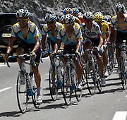 France, Sallanches, 22 July 2009: Astana riders surround the Maillot Jaune wearer Alberto Contador Velasco (Spa) Astana on the cat 2 climb of the Côte d'Araches during Stage 17 - the 169.5 km stage between Bourg-Saint-Maurice  and Le Grand-Bornand. Images from 2009 Tour de France cycle race. Photo by Peter Horrell / http://peterhorrell.com .