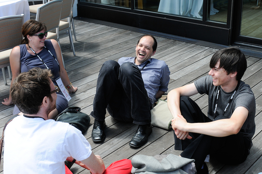 Audience members and presenters take a break on the deck at the Seaport World Trade Center in Boston's Innovation District.