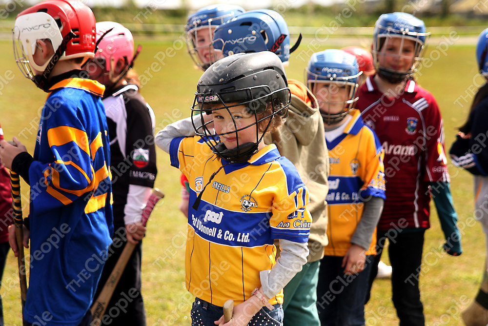 Ella Honan getting her helmet on duirng La na Scoileanna as part of the GAA 125 years celebrations in Gaelscoil Mhichil Chiosog in Ennis on Friday.<br /> Photograph by Yvonne Vaughan