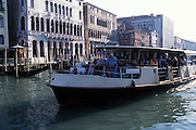 A Vaporetto, or waterbus, is one of the principal means of public transportation in Venice, Italy. Here, a Vaportetto is shown traveling the Grand Canal...Subject photograph(s) are copyright Edward McCain. All rights are reserved except those specifically granted by Edward McCain in writing prior to publication...McCain Photography.211 S 4th Avenue.Tucson, AZ 85701-2103.(520) 623-1998.mobile: (520) 990-0999.fax: (520) 623-1190.http://www.mccainphoto.com.edward@mccainphoto.com.
