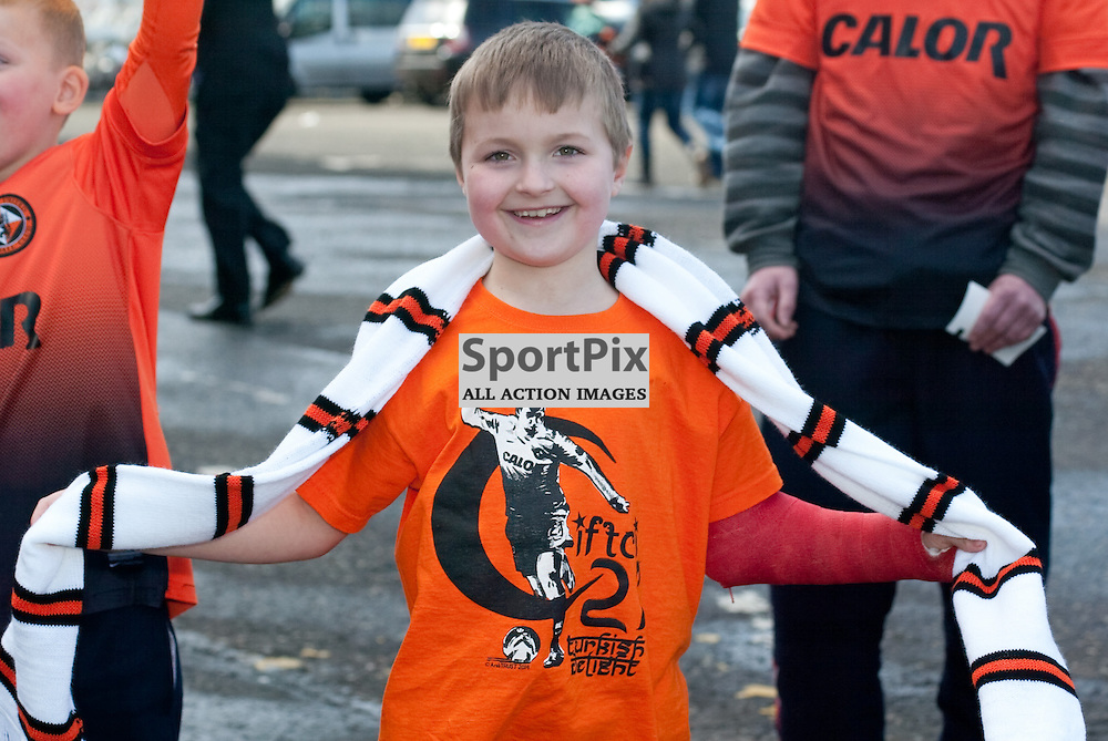 A young Dundee United fan shows his support for his team and striker Nadir Ciftci