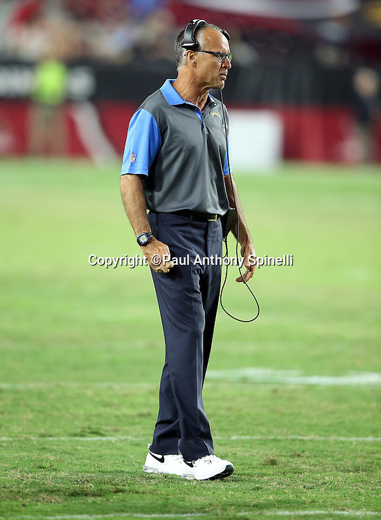 San Diego Chargers linebackers coach Mike Nolan looks on from near the sideline during the 2015 NFL preseason football game against the Arizona Cardinals on Saturday, Aug. 22, 2015 in Glendale, Ariz. The Chargers won the game 22-19. (©Paul Anthony Spinelli)