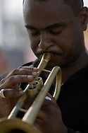 """Jazz musician Marlon Jordan playing """" A Closer Walk with Thee""""..Citizens of the 9th Ward of New Orleans marched over the two bridges over the industrial canal to commemorate the Hurricane Katrina disaster one year ago today..Residents of the Lower 9th threw flowers into the canal and then marched into Downtown New Orleans.."""