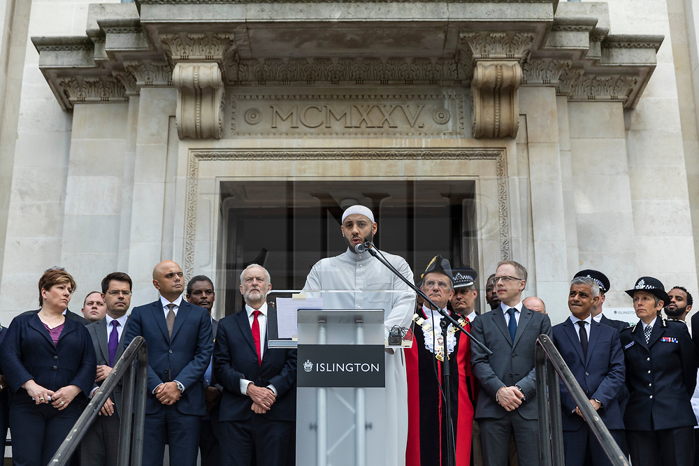 © Licensed to London News Pictures. 19/06/2018. London, UK. Imam Mohammed Mahmoud (centre) joins politicians, community and faith leaders, and members of Islington Council for a minute's silence on the steps of Islington Town Hall to mark the first anniversary of the Finsbury Park Attack. Photo credit: Rob Pinney/LNP