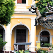 A fountain, horse-drawn carriage, and Spanish colonial architecture in Parque Central, Granada. Parque Central is the main square and the historic heart of Granada, Nicaragua.