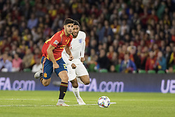 October 15, 2018 - Seville, Spain - MARCO ASENSIO of Spain (L) vies for the ball with JOE GOMEZ of England (R ) during the UEFA Nations League Group A4 soccer match between Spain and England at the Benito Villamarin Stadium (Credit Image: © Daniel Gonzalez Acuna/ZUMA Wire)